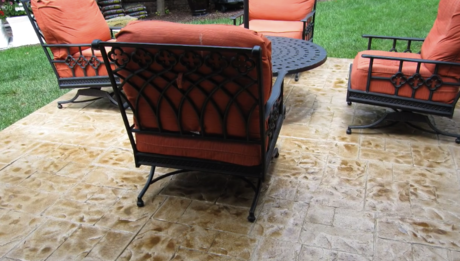 Chairs and a table on a decorative concrete patio in Hoover, Alabama