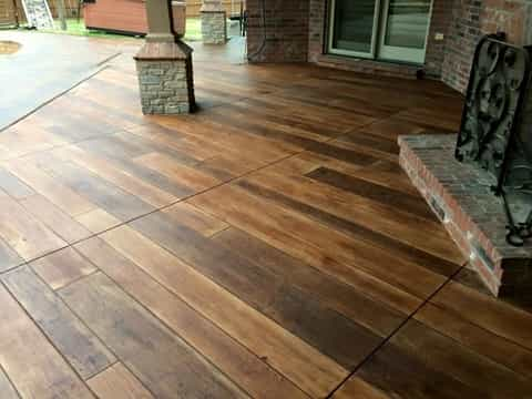 Concrete patio resurfaced to look like wood planks
