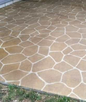 decorative concrete patio stamped to look like flagstone, stained light brown